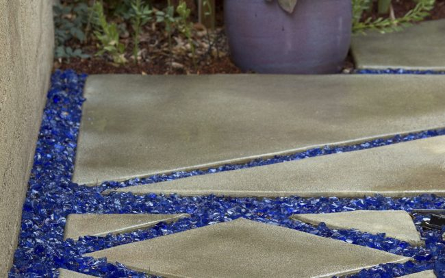 Concrete carpet pathway with recycled glass