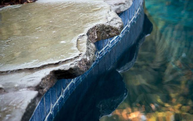 Rock slabs along pool coping