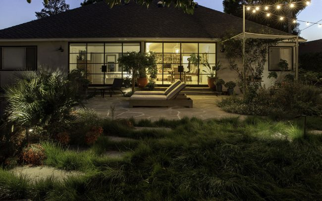 View at evening: Pathway through grass and patio