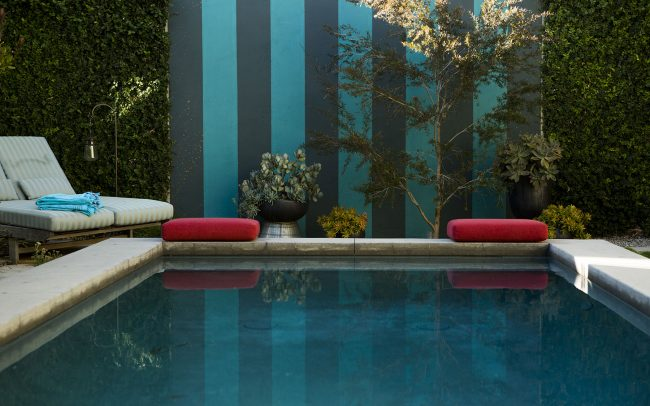 Striped wall end of pool with pot grouping