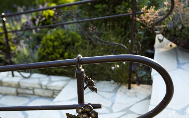 Custom iron railings with vining roses