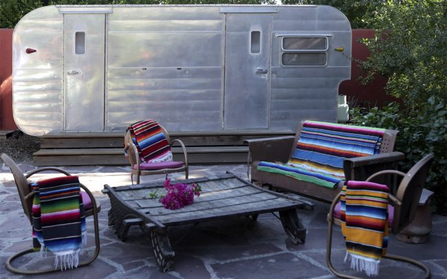 Shell chairs with Mexican blankets