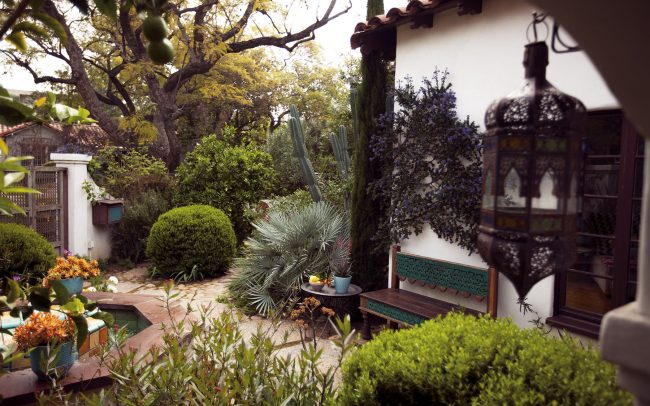 Entry courtyard with early California aesthetic