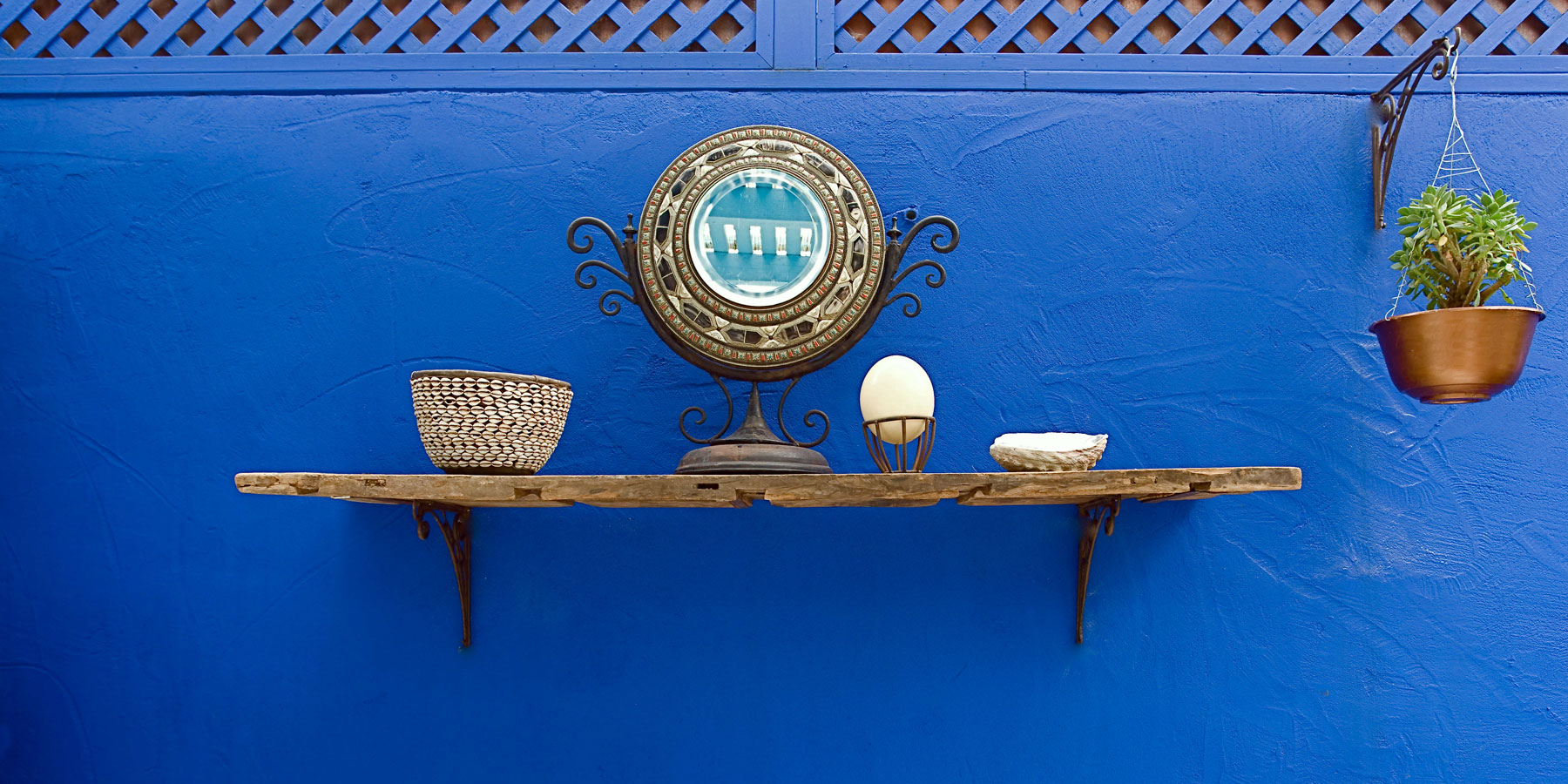 Blue wall, and shelf with African accents