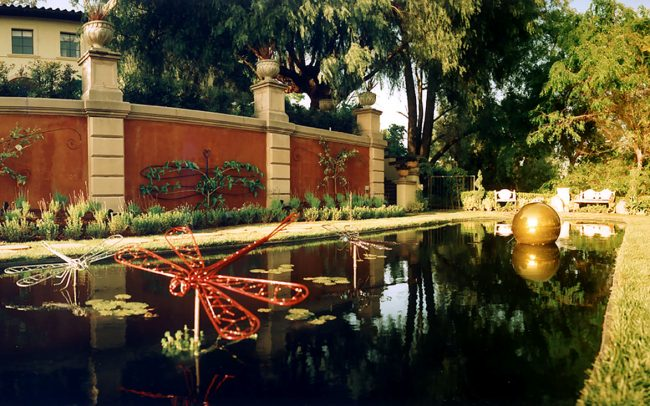 House and reflecting pond - panoramic view