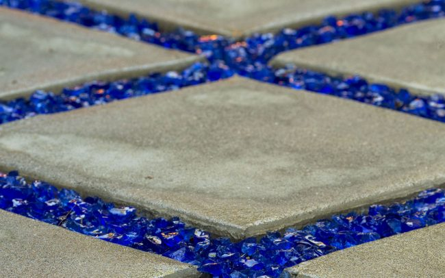 Concrete pathway with blue glass grout