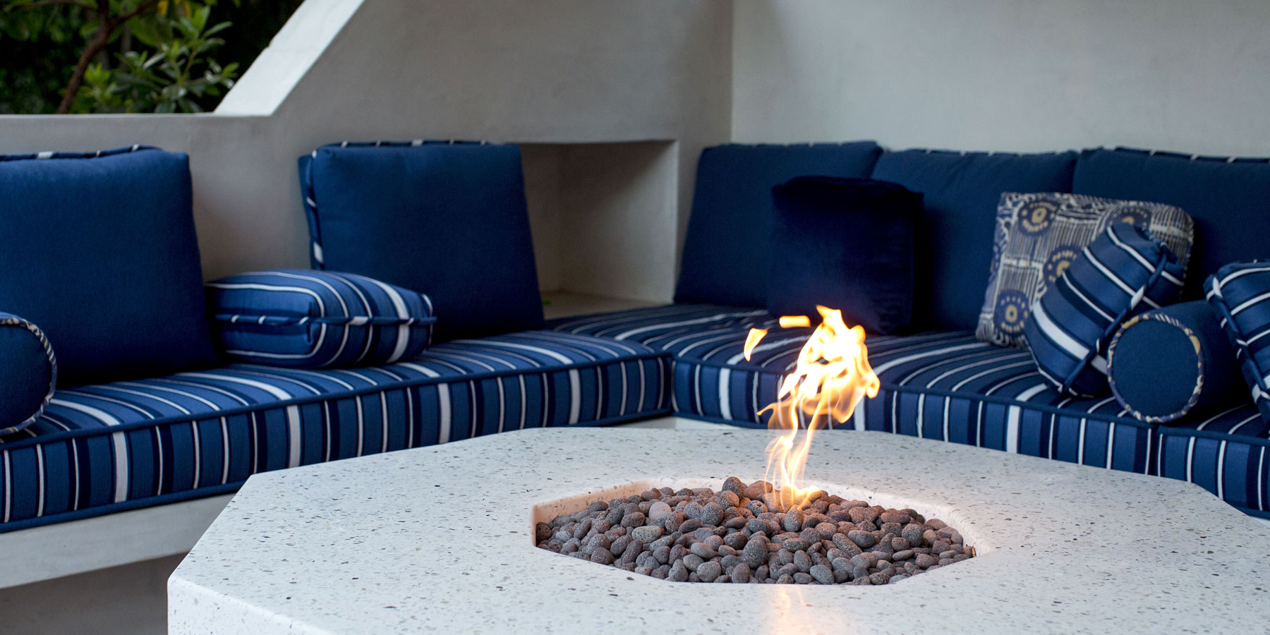 Custom upholstery and terrazzo fire table