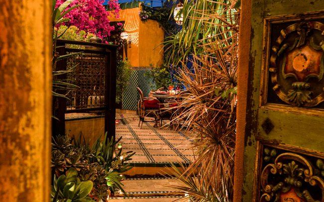 Carved doorway into Moroccan oasis